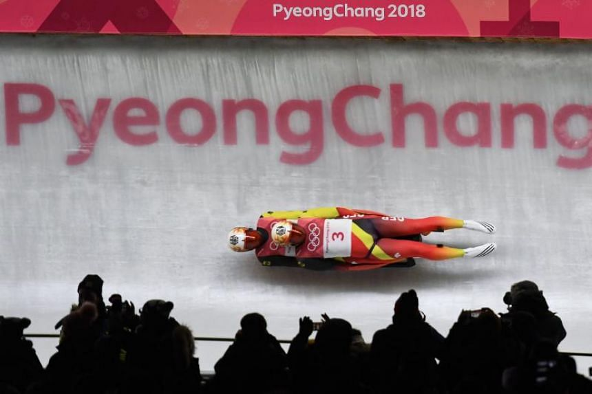 Germany's Tobias Wendl and Tobias Arlt compete in the doubles luge run 1 during the Pyeongchang 2018 Winter Olympic Games at the Olympic Sliding Centre on Feb 14, 2018.