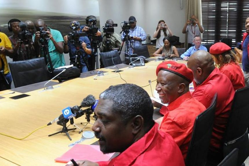 Opposition party leader Julius Malema (second from left) addresses a media conference in response to the resignation of President Jacob Zuma at the Houses of Parliament, Cape Town, on Feb 15, 2018.
