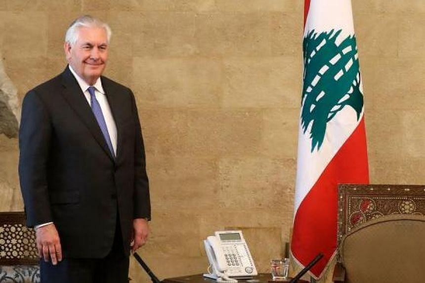 Television footage showed Mr Tillerson sitting in a room alongside an empty seat before his Lebanese counterpart, Foreign Minister Gebran Bassil, walked in and shook his hand.