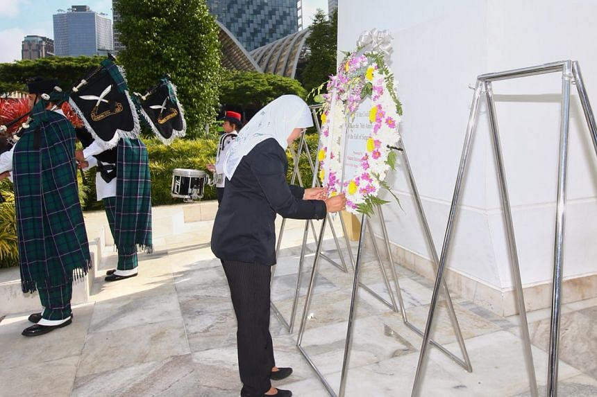 President Halimah Yacob laying a wreath at the foot of the 67m-high war memorial on Feb 15, 2018.