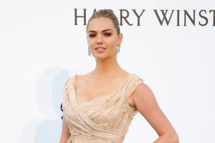 Model Kate Upton was swept off a rock by strong waves during a shoot for this year's Sports Illustrated Swimsuit.