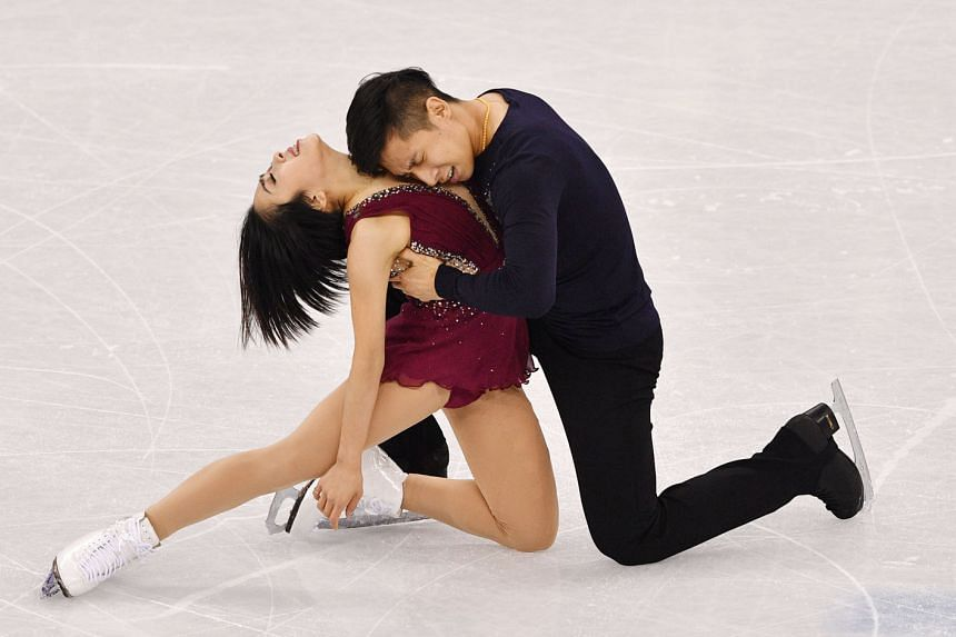Top: Leaders Sui Wenjing and Han Cong from China showing their sizzling chemistry in the pairs skating short programme at the Gangneung Ice Arena yesterday. Above: North Korea's Kim Ju Sik (left) and Ryom Tae Ok can hardly believe their personal-best