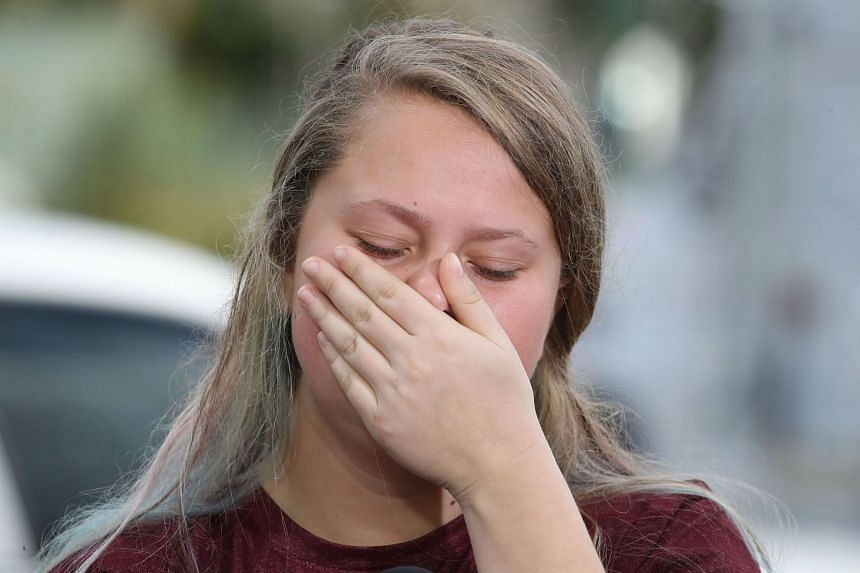 Student Kelsey Friend becomes emotional while recounting her story about the mass shooting.