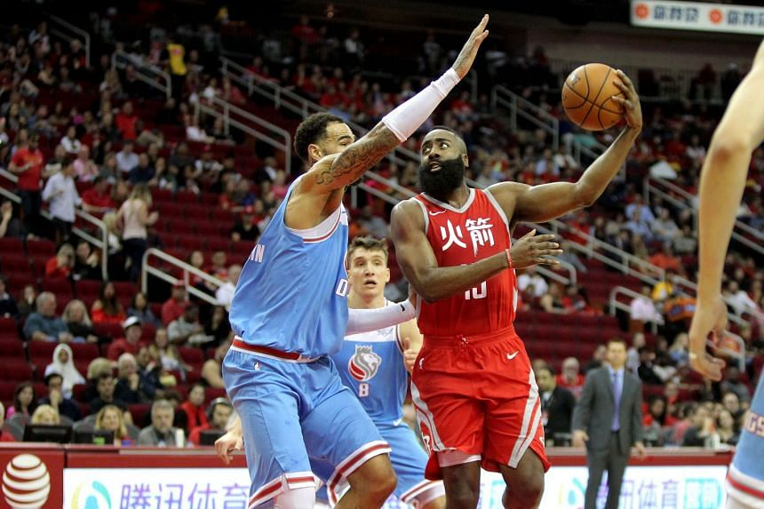 Houston Rockets guard James Harden (right) driving against Sacramento Kings centre Willie Cauley-Stein during their NBA match on Feb 14, 2018.