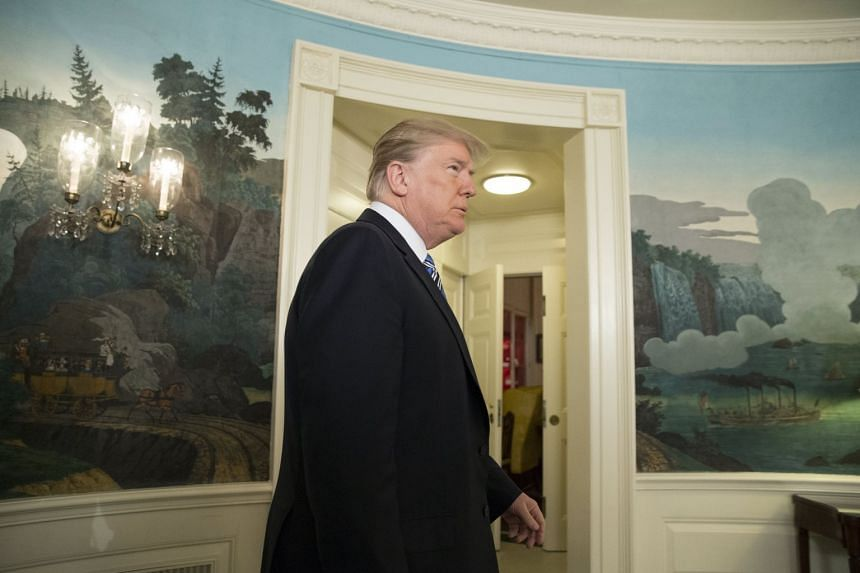 Trump arriving to deliver a speech at the White House.