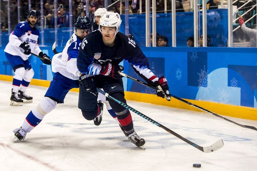 Ryan Donato (right) scored two power-play goals, keeping  the Americans in contention for a bye into the quarter-finals after squandering a late lead in a 3-2 loss to Slovenia.