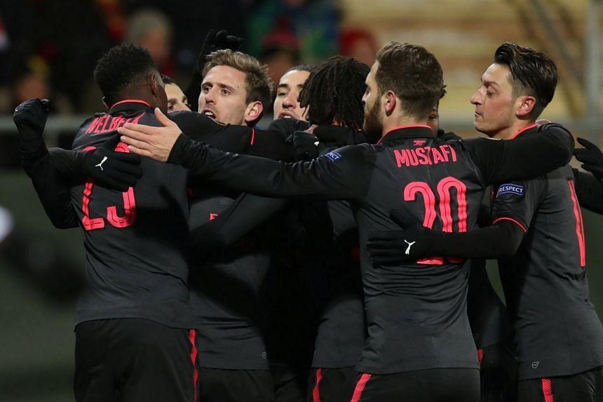 Arsenal's Nacho Monreal celebrates scoring their first goal with team mates.
