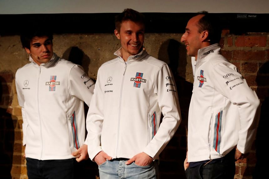 Williams drivers (from left) Lance Stroll, Sergey Sirotkin and Robert Kubica during the launch.