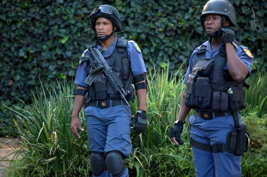 Police closing off roads around the home of the Gupta family, Feb 14, 2018.