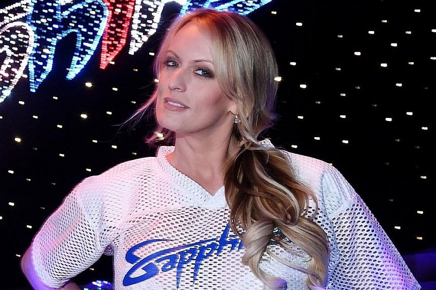 Ms Stormy Daniels believes she is free to tell her story after President Donald Trump's lawyer revealed that he had used his own money to pay the porn star. His statement violates a non-disclosure agreement, said Ms Daniel's manager.