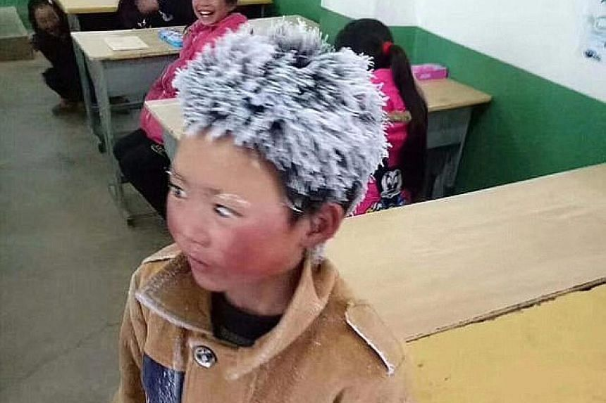 Far left: Wang Fuman with his hair and eyebrows encrusted with ice after a freezing, hour-long trek to school last month. Left: The eight-year-old is hoping for a Chinese New Year reunion with his mother, who walked out on her family two years ago.