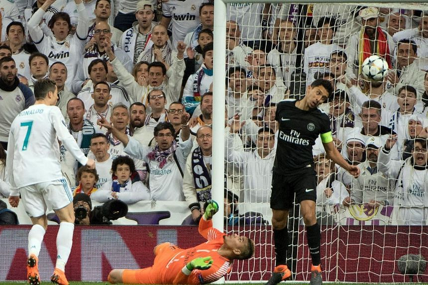 Cristiano Ronaldo scoring Real's second goal during their 3-1 come-from-behind win against Paris Saint-Germain in the Champions League first leg on Wednesday.