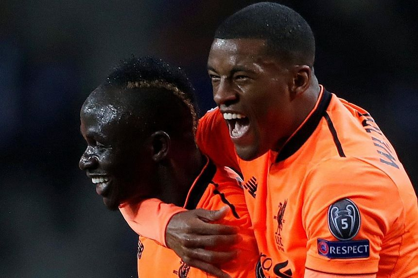Georginio Wijnaldum (right) embraces Sadio Mane after the Senegal striker became the fourth Liverpool player to score a Champions League hat-trick, during the 5-0 first-leg win against Porto on Wednesday.