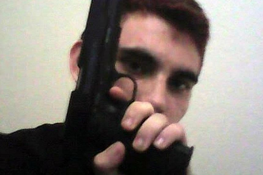 Screenshots from an Instagram page said to belong to Nikolas Cruz show many photos of him with firearms.