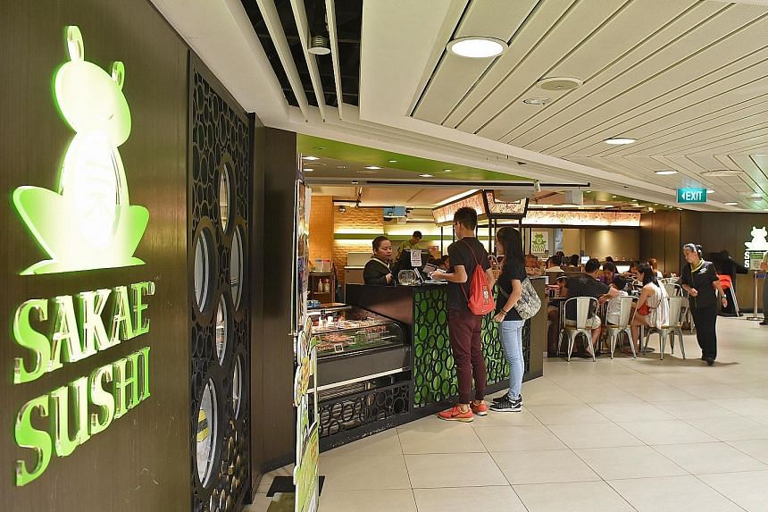 The Sakae Sushi outlet in Junction 8 mall. The group cut administrative expenses by 22 per cent during the fourth quarter, partly owing to a $5 million drop in labour costs.