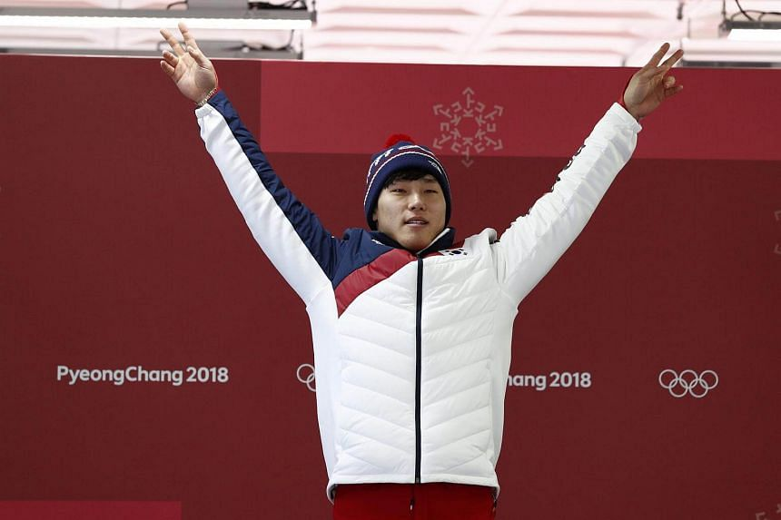 Gold medallist Yun Sung Bin of South Korea posing at the victory ceremony on Feb 16, 2018.