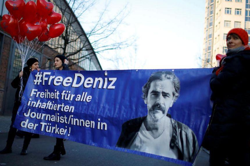 Protesters support arrested German-Turkish journalist Deniz Yucel in Berlin, Germany, on Feb 14, 2018.