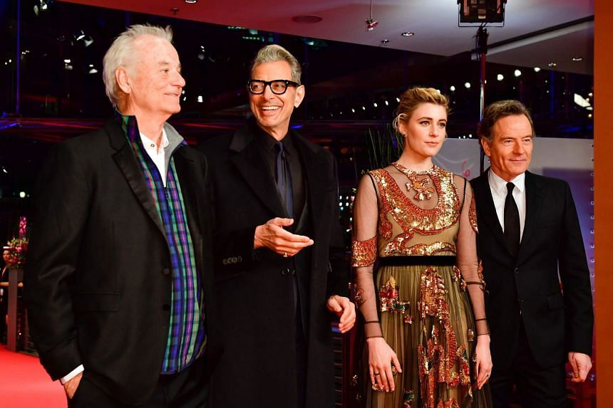 Actors (from left) Bill Murray, Jeff Goldblum, Greta Gerwig and Bryan Cranston pose on the red carpet for the opening ceremony.