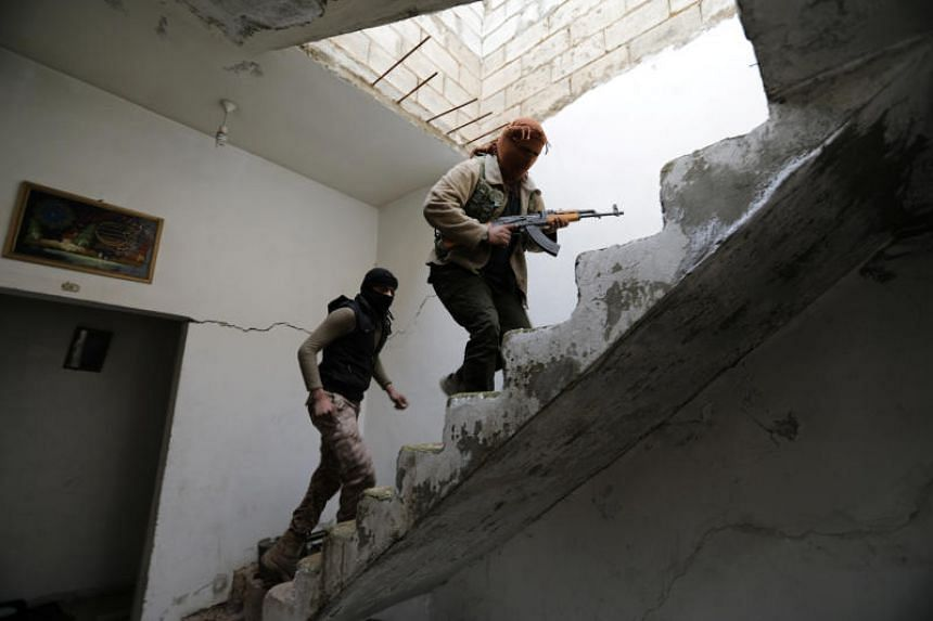 Turkey-backed Free Syrian Army fighters are seen in the eastern suburbs of al Bab, Syria on Feb 4, 2018.