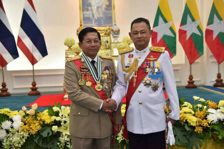 """Senior General Min Aung Hlaing posted a photo to his official Facebook page alongside his Thai counterpart as he received the """"Knight Grand Cross First Class of the Most Exalted Order of the White Elephant"""" in Bangkok."""