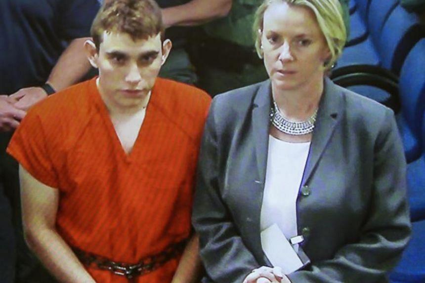 Nikolas Cruz (left), 19, carried a black duffel bag and backpack, where he hid loaded magazines.