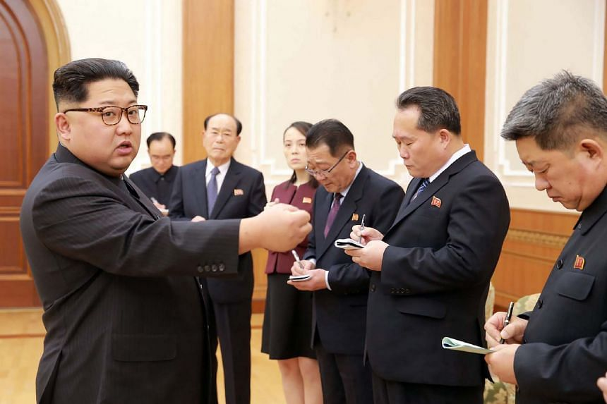 North Korean leader Kim Jong-Un (left) greeting members of the South Korea Winter Olympics delegation.