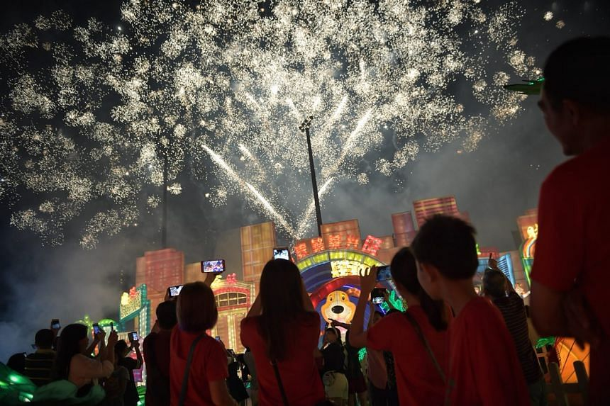 Fireworks fill the air as the clock strikes 12 at the River Hongbao.