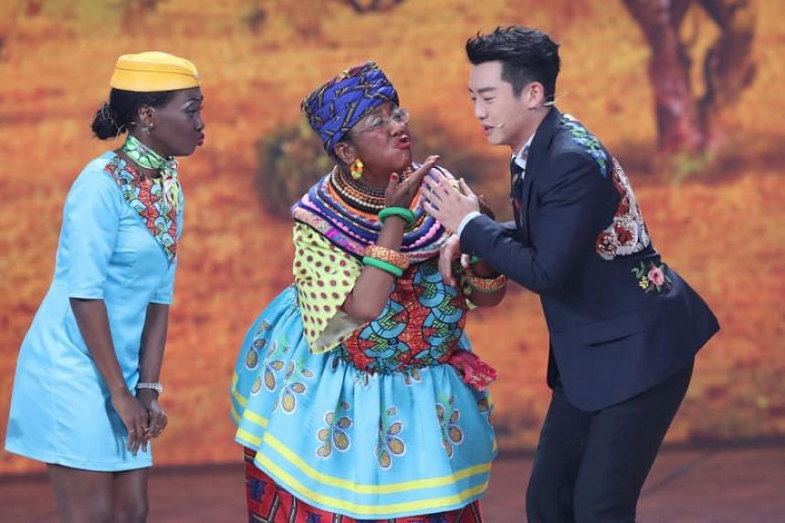 The actress, Lou Naiming (centre), appeared on stage in colourful garb with her face and arms coloured brown, carrying a fruit basket on her head, and accompanied by someone costumed as a monkey.