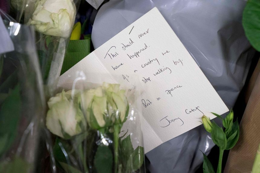 A note from Jeremy Corbyn is seen at the spot where an unnamed Portuguese man was found dead.