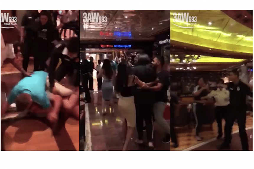 Video taken by passengers showed more than a dozen people fighting on the ship as crew members struggled to break up the violence.