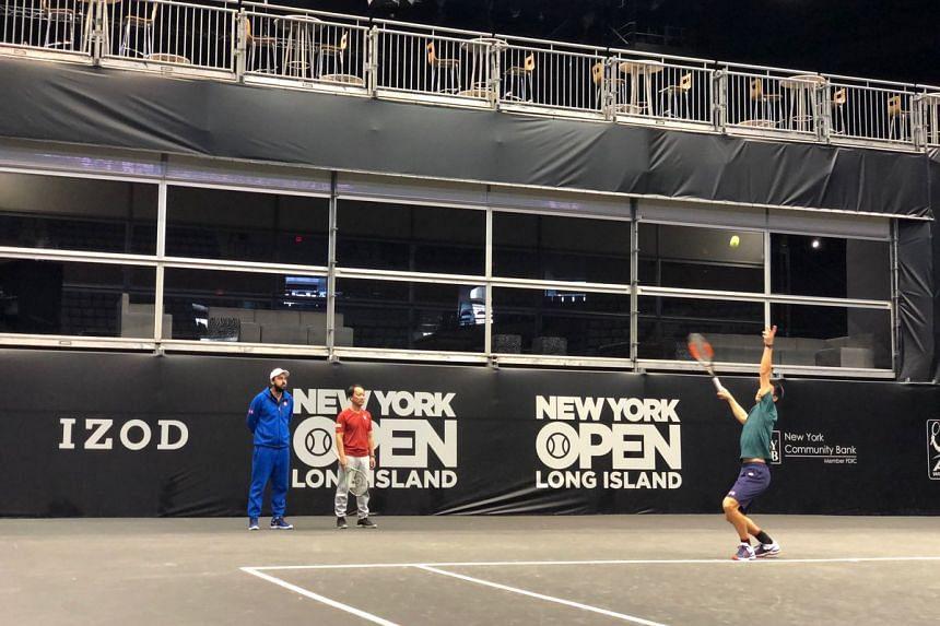 Kei Nishikori practises before the match at the New York Open.