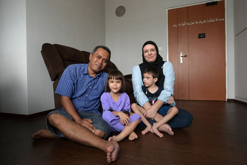 Mr Mohd Aszrin with his wife Tasha Ahrens and their children Dean Joaquin and Sara Elizabeth. Mr Aszrin was one of the 3,000 rental flat tenants who bought their homes in the last five years.