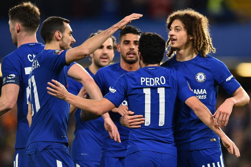 Chelsea's Spanish midfielder Pedro celebrates scoring the team's second goal with team mates.