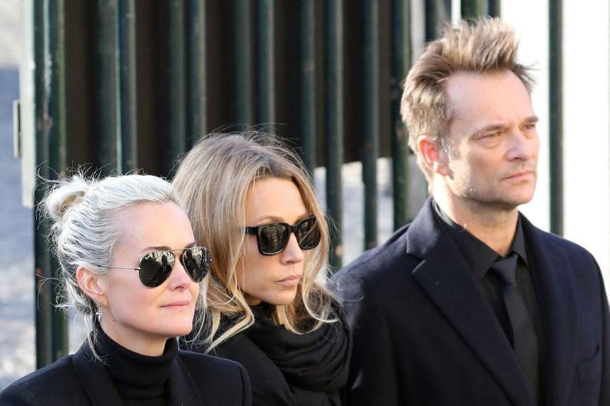 (From left) Wife Laeticia Hallyday, with her husband's daughter Laura Smet and son David Hallyday at the singer's funeral.