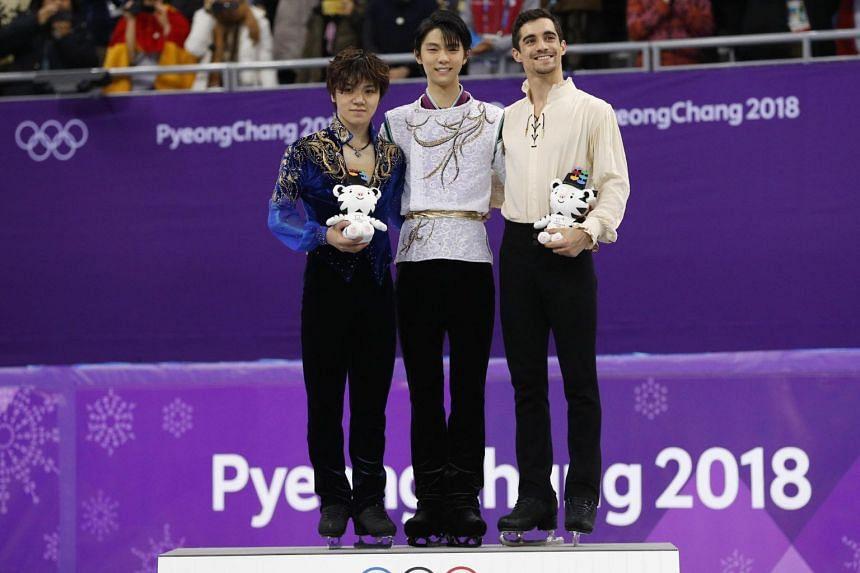 (From left) Silver medallist Shoma Uno, gold medallist Yuzuru Hanyu and bronze medallist Javier Fernandez on the podium after the men's free skating event, on Feb 17, 2018.