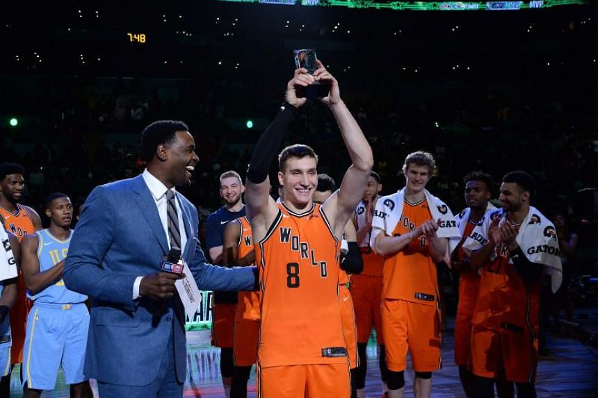 Bogdan Bogdanovic of the World Team raises the Rising Stars Challenge MVP Trophy with Chris Webber during the 2018 Mountain Dew Kickstart Rising Stars Game at Staples Center on Feb 16, 2018.