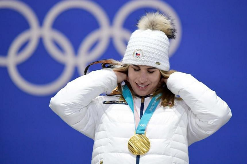 Czech Republic's gold medallist Ester Ledecka adjusts her medal on the podium during the medal ceremony for the alpine skiing women's Super-G at the Pyeongchang Medals Plaza during the Pyeongchang 2018 Winter Olympic Games in Pyeongchang on Feb 17, 2
