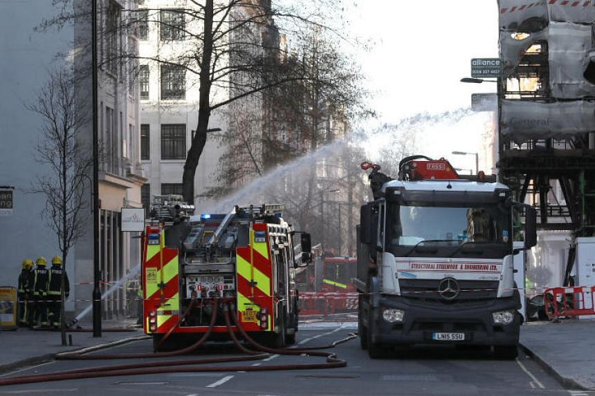 London Fire Brigade said more than 50 firefighters and 10 engines were attending the fire at a building under refurbishment on Great Portland Street.
