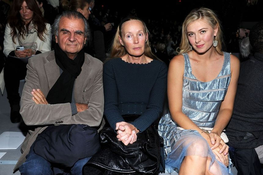 Patrick Demarchelier (left), with Mia Demarchelier (centre), and Maria Sharapova (right) at the Marc Jacobs Collection front row New York State Armory in New York City on Feb 12, 2012.