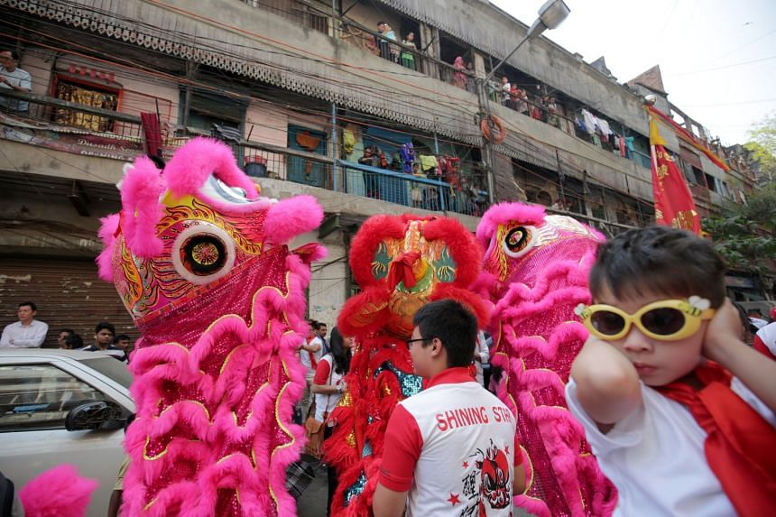 The Year of the Dog was ushered in at 11.30pm on Feb 15 in the eastern Indian city with lion dance troupes taking over the roads surrounded by large crowds of people.