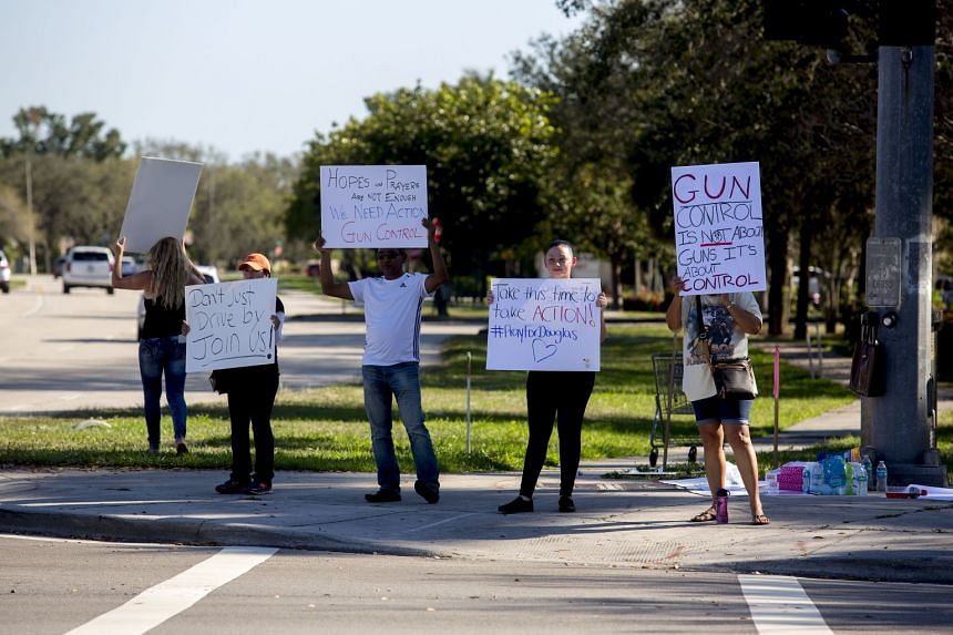 Protesters along a road in Coral Springs, Fla., two days after a shooting at the nearby Marjory Stoneman Douglas High School, on Feb 16, 2018.
