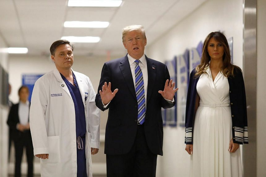 US President Donald Trump and First Lady Melania Trump visit with Dr Igor Nichiporenko, a trauma surgeon at Broward Health North Hospital in the wake of the shooting at Marjory Stoneman Douglas High School.