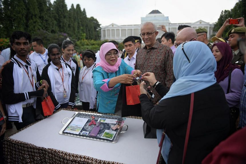 President Halimah Yacob meets beneficiaries of the President's Challenge after the unveiling, on Feb 17, 2018.