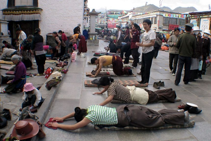 Buddhists asking for forgivenness at Jokhang Temple in Tibet.