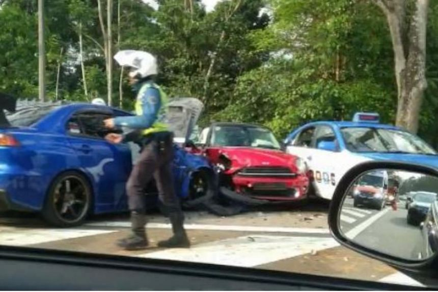 A compilation of dashboard camera footage posted on Facebook group Roads.sg showed a red car crashing into the rear of a dark blue car, before spinning into the next lane.