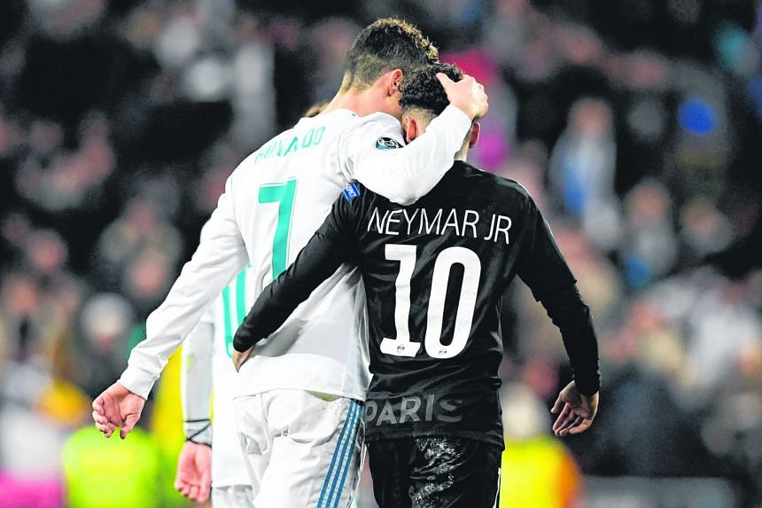 """Real Madrid's Cristiano Ronaldo and Paris Saint-Germain's Neymar at half-time during the Champions League game on Wednesday. Real came from behind to win 3-1 and former Brazil striker Walter Casagrande said of Neymar: """"He doesn't have the quality of"""