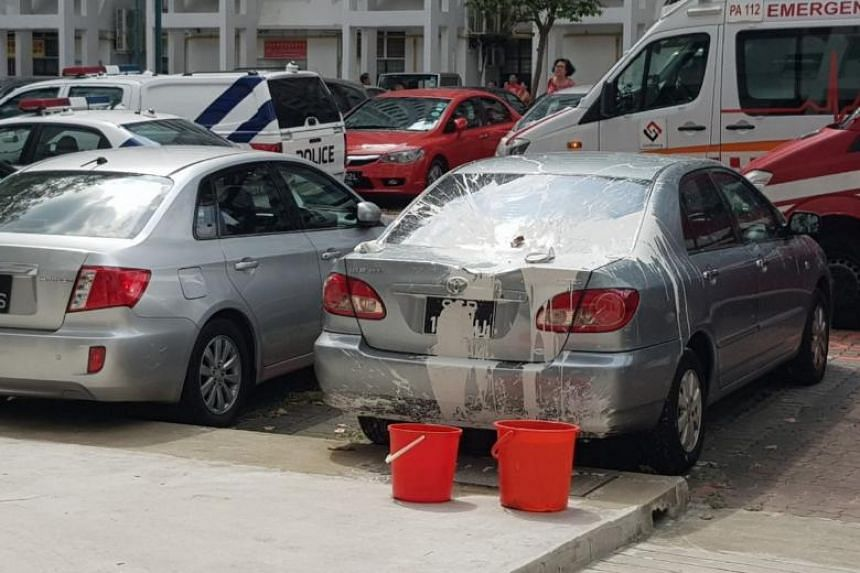 A man was arrested after he was caught throwing household items and cans of paint from his fourth-floor flat in Boon Keng. Photos showed at least two cars in the car park that had been smeared with white paint.