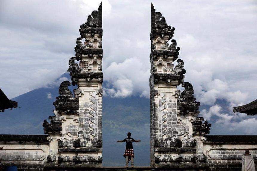 A man at the gate of Lempuyang temple in Bali.