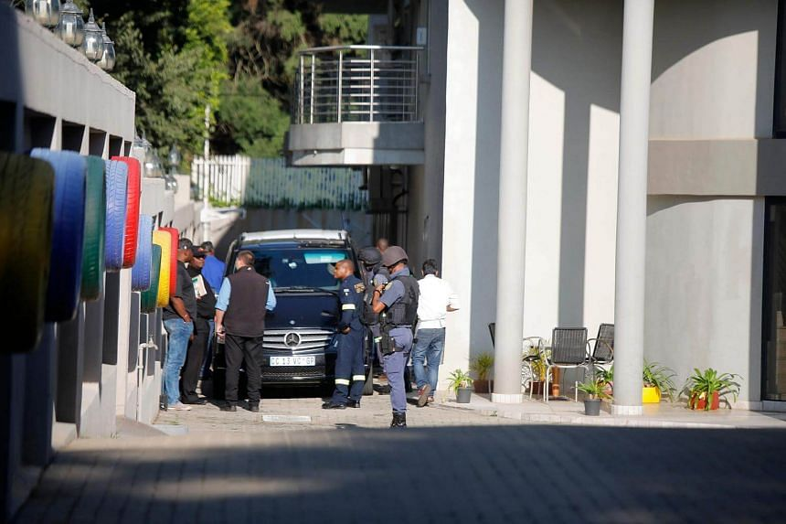 A police van and uniformed and plain clothes police officers are seen inside the compound of the controversial business family Gupta in South Africa, on Feb 14, 2018.