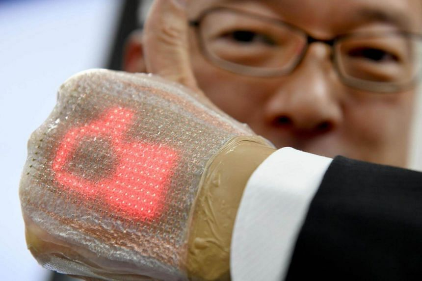 The band-aid-like device is just one millimetre thick and can monitor important health data as well as send and receive messages, including emojis.